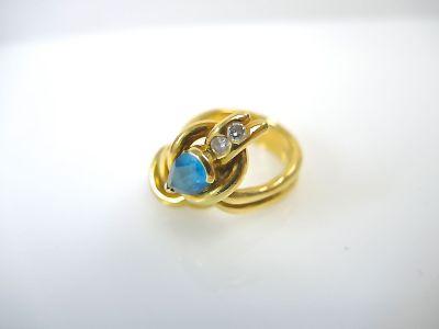 Blue Topaz and Diamond Knot Motif Ring