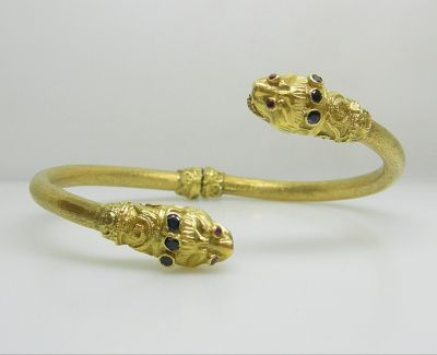 Gold Bangle with Mythical Heads