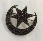 Silver Gilt Garnet Crescent and Star Brooch