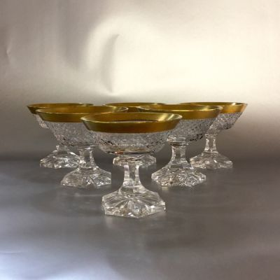 Set of nine Gold Rimmed Crystal Cordial Glasses